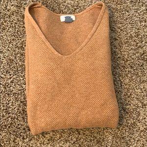 I'm selling a orange V-neck sweater for $15
